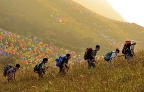 Over 15,000 People Set Up Colorful Camp On China Hillside