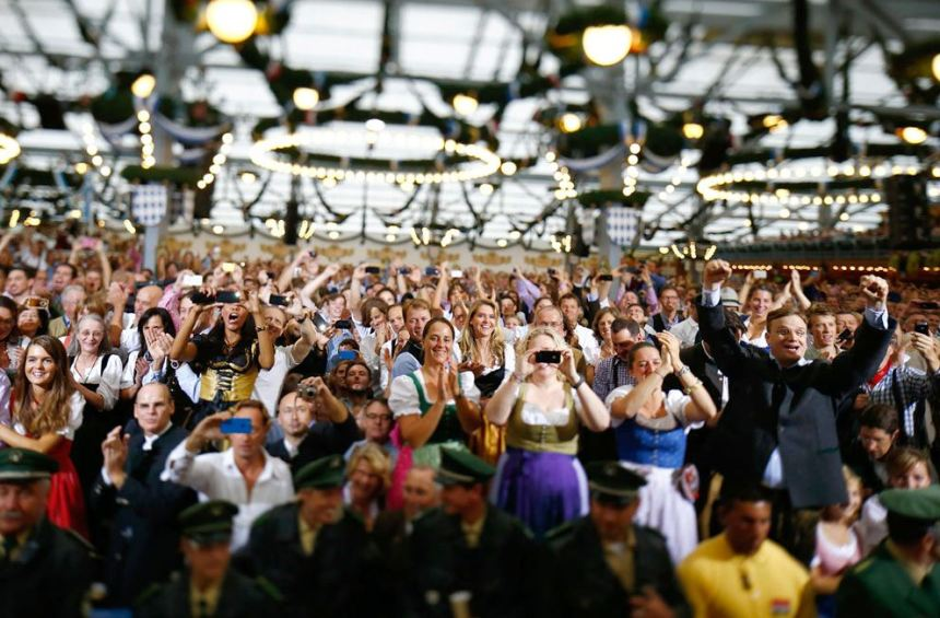 Revelers celebrate during the opening of the 179th Oktoberfest in Munich