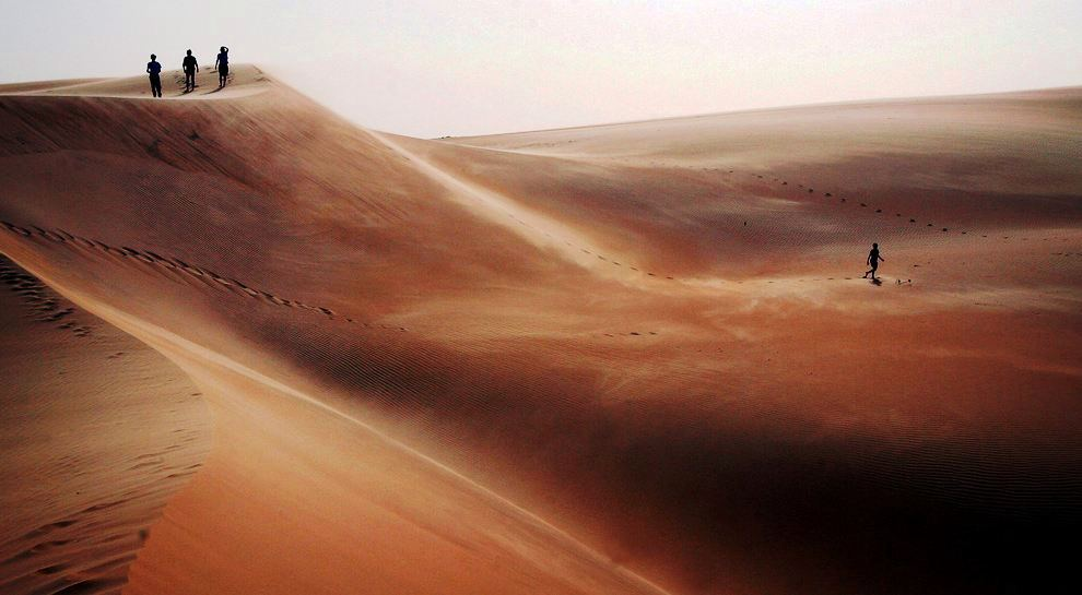 Tourists explore sand dunes in the Mauritanian desert