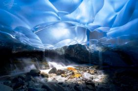 Light Well within the Mendenhall Glacier, Alaska - photo by Sean Yan