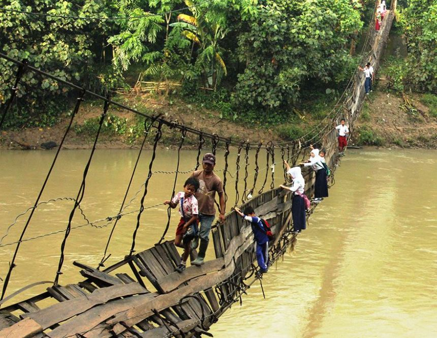 Pupils Crossing A Damaged Suspension Bridge, Lebak, Indonesia