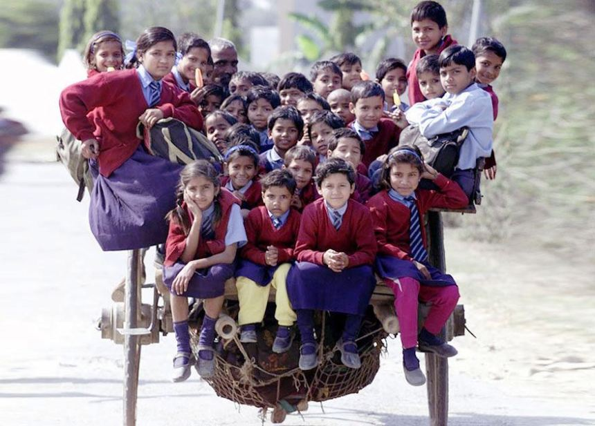Schoolchildren Riding A Horse Cart Back From School in Delhi, India