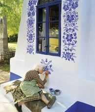 Grandmother Agnes Kašpárková delicately paints traditional Moravian ornament, Czech Republic