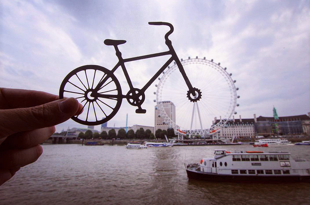 London Eye seen through a bicycle wheel